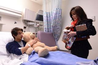 Flamingo headliner Marie Osmond hands out Christmas gifts to pediatric patients at Children's Hospital of Nevada at University Medical Center on Monday, Dec. 23, 2013, in Las Vegas.