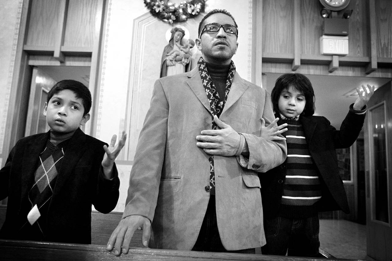 Arturo Martinez-Sanchez, center, attends Christmas Eve Mass with his sons, Cristopher, 10, left, and Alejandro, 5, at St. Christopher Catholic Church in North Las Vegas on Dec. 24, 2012.