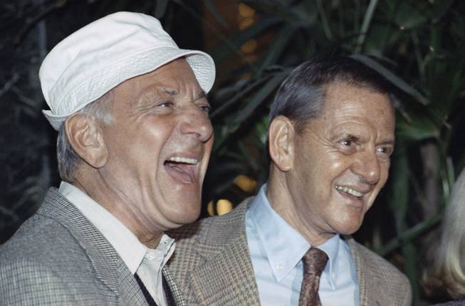 "In this Dec. 3, 1992, file photo, Jack Klugman, left, and Tony Randall laugh at a news conference announcing that they will reprise their most famous roles as Oscar Madison and Felix Unger respectively, for a one-night benefit performance of Neil Simons play, ""The Odd Couple,"" in Beverly Hills, Calif. Klugman, the prolific, craggy-faced character actor and regular guy who was loved by millions as the messy one in TV's ""The Odd Couple"" and the crime-fighting coroner in ""Quincy, M.E.,"" died Monday, a son said. He was 90."