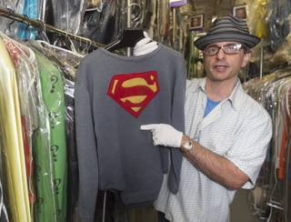 In this Friday, Nov. 30, 2012 photo, James Comisar holds the costume George Reeves wore in the 1950s TV show
