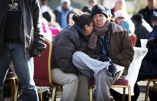 Byron Martin sits with his wife, who did not want her name used, during a Christmas Day event to feed and clothe the homeless and needy organized by the nonprofit organization Broken Chains in Las Vegas on Tuesday, December 25, 2012.