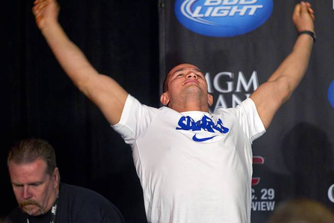 UFC heavyweight champions Junior Dos Santos of Brazil stretches during a news conference at the MGM Grand Thursday, Dec. 27, 2012. Dos Santos will defend the title against Cain Velasquez of San Jose, Calif. during UFC155 at the MGM Grand Garden Arena Saturday .
