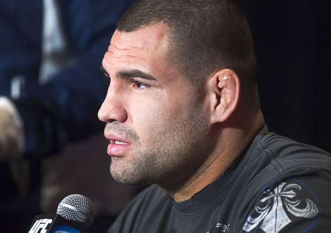 Former UFC heavyweight champion Cain Velasquez of San Jose, Calif. responds to a question during a news conference at the MGM Grand Thursday, Dec. 27, 2012. Velasquez will try and reclaim his title from heavyweight champion Junior Dos Santos of Brazil during UFC155 at the MGM Grand Garden Arena Saturday.