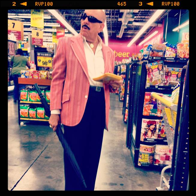 In this Instagram, a sharp dressed man waits in the checkout at a Las Vegas grocery store.