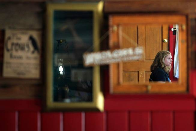 Las Vegas Weekly writer Kristen Peterson is reflected in a mirror at the Crow Bar in Shoshone, Calif.