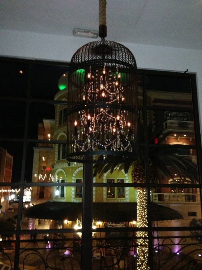 A birdcage chandelier at Angelo Sosa's Poppy Den in Tivoli Village.