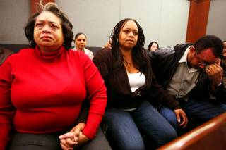 Claudette Flanagan-Jones, from left, Jade Morris' grandmother, Tejuana Reeves-Morris, Jade's mother, and Andres Mack, Jade's grandfather, watch as Brenda Stokes appears in Las Vegas Justice Court for a hearing Friday, Dec. 28, 2012, at the Regional Justice Center.