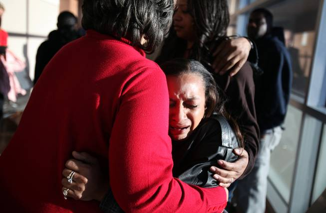 Brenda Morris, right, Jade Morris' grandmother, cries and hugs Jade's other grandmother Claudette Flanagan-Jones, in red, outside the courtroom after Brenda Stokes appeared in Las Vegas Justice Court for a hearing at the Regional Justice Center on Friday, December 28, 2012.