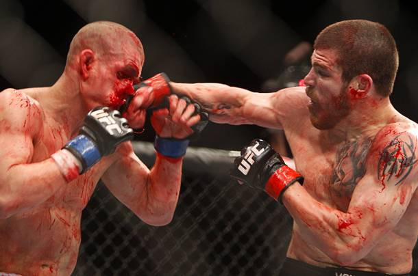 Jim Miller, right, of Whippany, N.J. connects on Joe Lauzon of Bridgewater, Mass. during a lightweight bout UFC155 at the MGM Grand Garden Arena Saturday, Dec. 29, 2012. Miller defeated Lauzon by unanimous decision.
