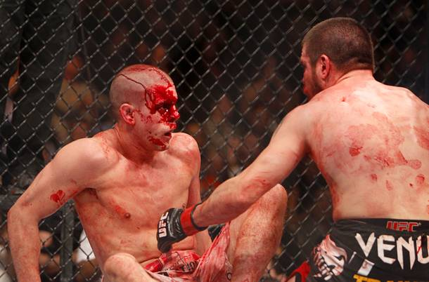 Joe Lauzon, left, of Bridgewater, Mass. and Jim Miller of Whippany, N.J. separate at the end of a bloody lightweight bout during UFC155 at the MGM Grand Garden Arena Saturday, Dec. 29, 2012. Miller defeated Lauzon by unanimous decision.