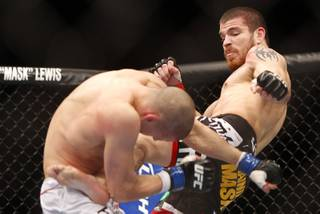 Jim Miller of Whippany, N.J. kicks Joe Lauzon of Bridgewater, Mass. during the first round of a lightweight bout UFC155 at the MGM Grand Garden Arena Saturday, Dec. 29, 2012. Miller defeated Lauzon by unanimous decision.