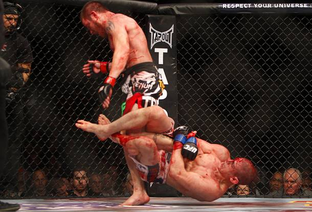 Jim Miller, left, of Whippany, N.J. gets away from a take down attempt by Joe Lauzon of Bridgewater, Mass. in a lightweight bout during UFC155 at the MGM Grand Garden Arena Saturday, Dec. 29, 2012. Miller defeated Lauzon by unanimous decision.