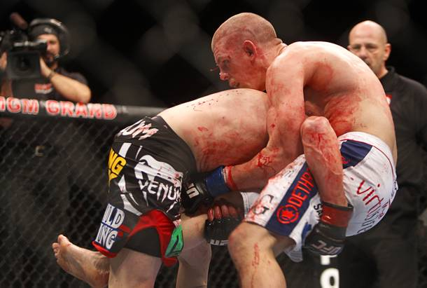 Jim Miller, left, of Whippany, N.J. attempts to take down Joe Lauzon of Bridgewater, Mass. in a lightweight bout during UFC155 at the MGM Grand Garden Arena Saturday, Dec. 29, 2012. Miller defeated Lauzon by unanimous decision.