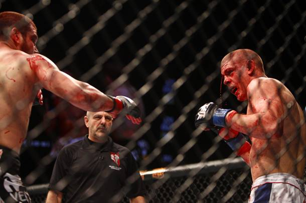 Jim Miller, left, of Whippany, N.J. fights with Joe Lauzon of Bridgewater, Mass. in a lightweight bout during UFC155 at the MGM Grand Garden Arena Saturday, Dec. 29, 2012. Miller defeated Lauzon by unanimous decision.