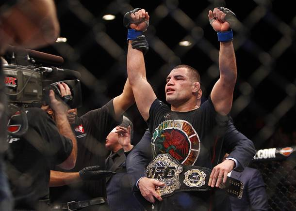 Cain Velasquez is named the champion after defeating Junior Dos Santos during a heavyweight title bout UFC155 at the MGM Grand Garden Arena Saturday, Dec. 29, 2012. Velasquez reclaimed the belt by unanimous decision.