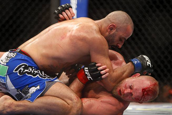 Costa Philippou of Long Island, N.Y. wrestles with Tim Boetsch of Sunbury, Penn. during a middleweight bout UFC155 at the MGM Grand Garden Arena Saturday, Dec. 29, 2012. Philippou won by third round TKO.