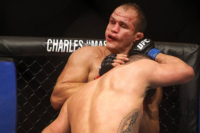Heavyweight champion Junior Dos Santos top, gets hit by Cain Velasquez during a heavyweight title bout UFC155 at the MGM Grand Garden Arena Saturday, Dec. 29, 2012. Velasquez reclaimed the belt by unanimous decision.