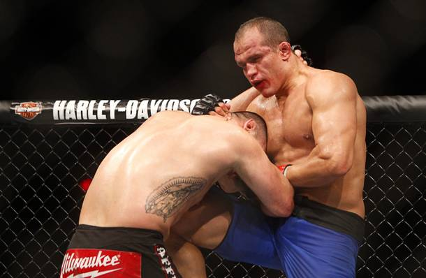 Heavyweight champion Junior Dos Santos, right, knees Cain Velasquez during a heavyweight title bout UFC155 at the MGM Grand Garden Arena Saturday, Dec. 29, 2012. Velasquez reclaimed the belt by unanimous decision.