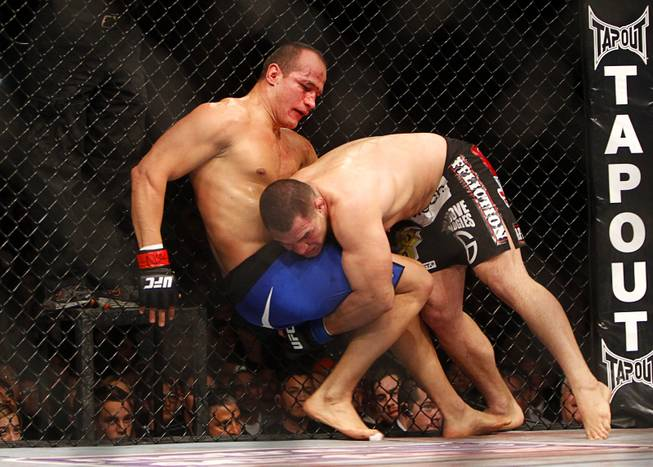 Cain Velasquez, right, attempts to take down heavyweight champion Junior Dos Santos during a heavyweight title bout UFC155 at the MGM Grand Garden Arena Saturday, Dec. 29, 2012. Velasquez reclaimed the belt by unanimous decision.