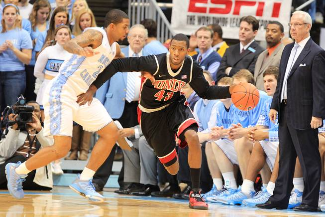 UNLV forward Mike Moser is guarded by North Carolina forward Leslie McDonald during their game Saturday, Dec. 29, 2012 at the Dean Smith Center in Chapel Hill, N.C.