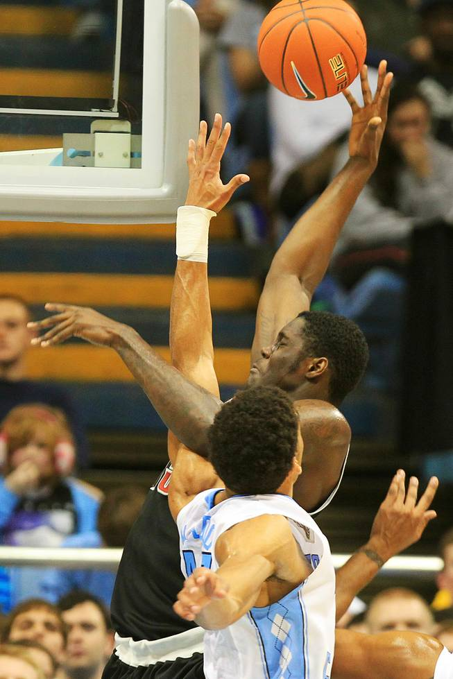 UNLV forward Anthony Bennett is fouled by North Carolina forward James Michael McAdoo during their game Saturday, Dec. 29, 2012 at the Dean Smith Center in Chapel Hill, N.C.