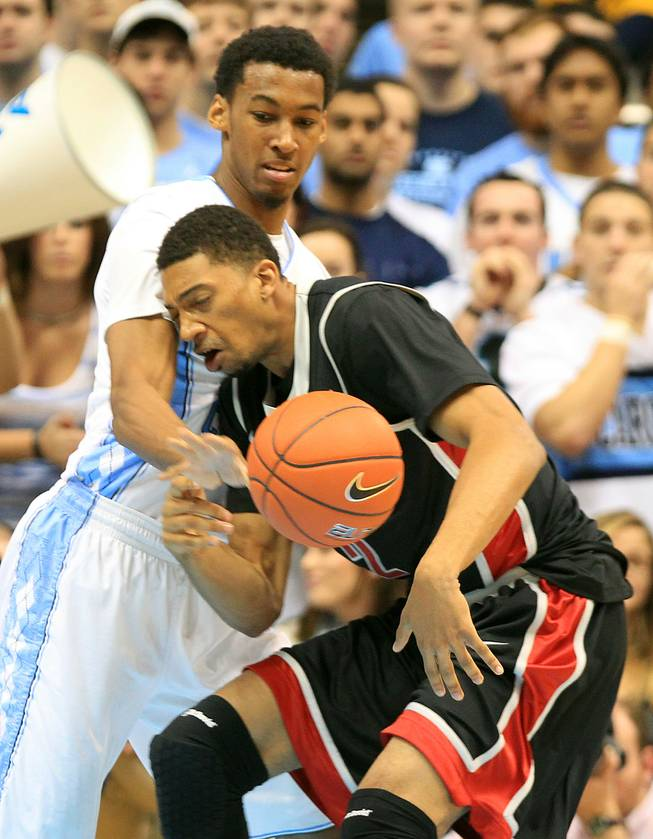 UNLV forward Khem Birch is fouled by North Carolina forward Desmond Hubert during their game Saturday, Dec. 29, 2012 at the Dean Smith Center in Chapel Hill, N.C.