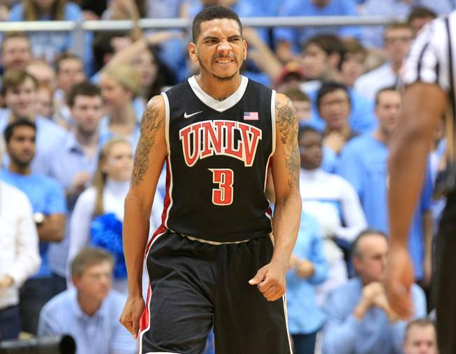UNLV guard Anthony Marshall grimaces while coming off the court during the final seconds of their 79-73 loss to North Carolina Saturday, Dec. 29, 2012 at the Dean Smith Center in Chapel Hill, N.C.