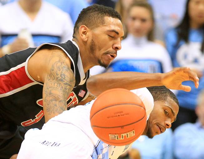 UNLV guard Anthony Marshall knocks the ball away from North Carolina guard Joel James during their game Saturday, Dec. 29, 2012 at the Dean Smith Center in Chapel Hill, N.C. North Carolina won the game 79-73.