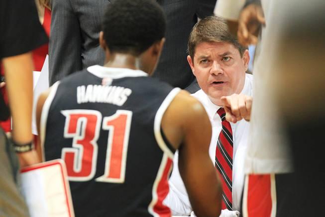 UNLV head coach Dave Rice talks to his team during a timeout in their game against North Carolina on Saturday, Dec. 29, 2012, at the Dean Smith Center in Chapel Hill, N.C. North Carolina won the game 79-73.
