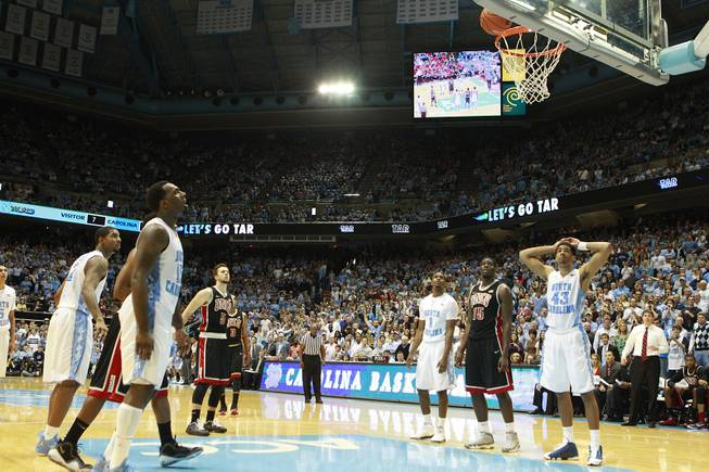 UNLV guard Katin Reinhardt watches as his free throw bounces out of the basket late in their game against North Carolina Saturday, Dec. 29, 2012 at the Dean Smith Center in Chapel Hill, N.C. North Carolina won the game 79-73.
