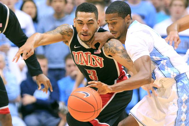 UNLV guard Anthony Marshall defends North Carolina guard Dexter Strickland during their game Saturday, Dec. 29, 2012 at the Dean Smith Center in Chapel Hill, N.C. North Carolina won the game 79-73.