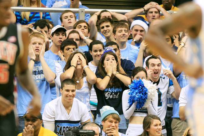North Carolina fans react after one of their players was called for a foul during their game against UNLV Saturday, Dec. 29, 2012 at the Dean Smith Center in Chapel Hill, N.C. North Carolina won the game 79-73.