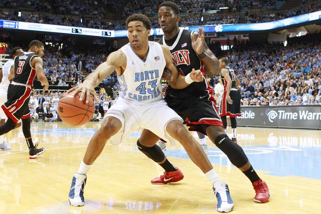 UNLV forward Quintrell Thomas guards North Carolina forward James Michael McAdoo during their game Saturday, Dec. 29, 2012 at the Dean Smith Center in Chapel Hill, N.C. North Carolina won the game 79-73.