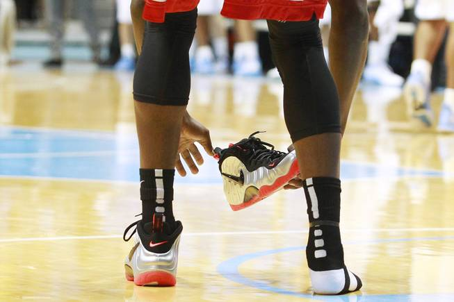 UNLV forward Savon Goodman puts his shoe back on during their game against North Carolina Saturday, Dec. 29, 2012 at the Dean Smith Center in Chapel Hill, N.C. North Carolina won the game 79-73.