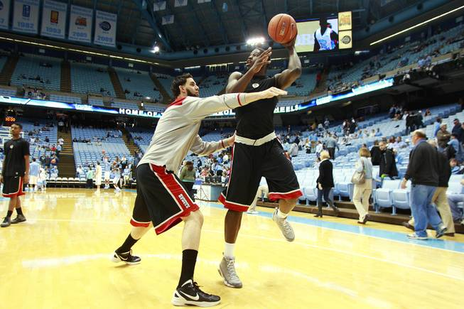 UNLV forward Carlos Lopez-Sosa and Anthony Bennett warm up before their game against North Carolina Saturday, Dec. 29, 2012 at the Dean Smith Center in Chapel Hill, N.C.