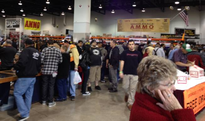 People crowded Cashman Center Saturday for the Crossroads of the West Gun Show, which ends Sunday, Dec. 30, 2012.
