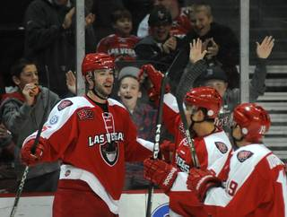 Andrew Sarauer (25) celebrates with teammates after scoring a third period goal against the Idaho Steelheads on Sunday afternoon at the Orleans Arena.