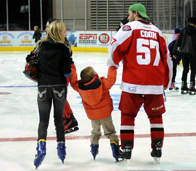 Las Vegas Wranglers defenseman Charlie Cook helps a young fan skate along the ice at the Orleans Arena as the team invited fans to join the players on the ice after the game on Dec. 31, 2012.