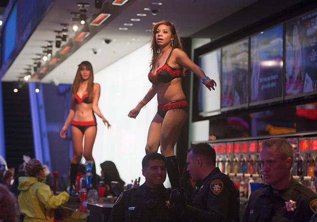 Go go dancers performs at the D Bar during the New Years Eve party at the Fremont Street Experience Monday, Dec. 31, 2012.