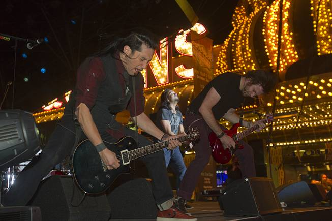 Members of the band Pop Evil perform during the New Years Eve party at the Fremont Street Experience Monday, Dec. 31, 2012.