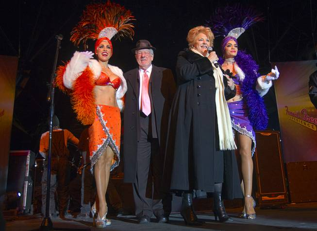 Las Vegas Mayor Carolyn Goodman and her husband Oscar Goodman arrive with showgirls Jennifer Johnson, left, and Porsha Revesz during the New Years Eve party at the Fremont Street Experience Monday, Dec. 31, 2012.