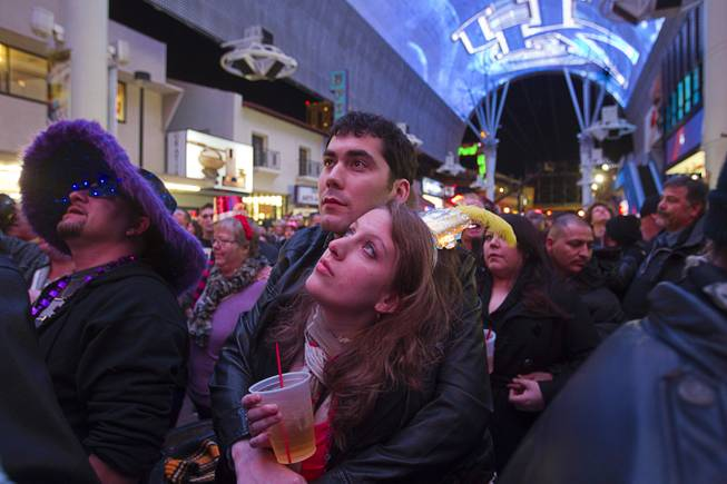 Troy Nuccio and Danielle Weber of Detroit wait for fireworks just before midnight during the New Years Eve party at the Fremont Street Experience Monday, Dec. 31, 2012.