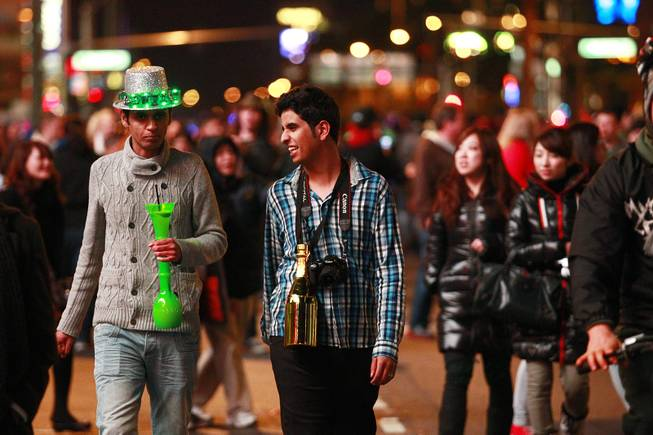 Revelers walk up and down the Strip for the annual New Year's Eve celebration Monday, Dec. 31, 2012.