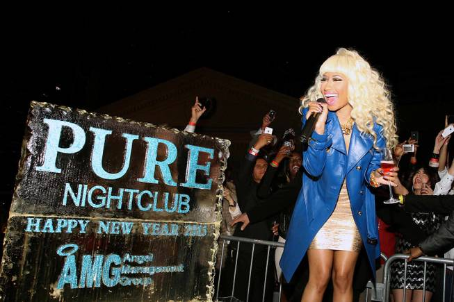 Nicki Minaj hosts the New Year's Eve soiree at Pure ...