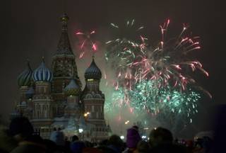 Fireworks explode in the sky over St. Basil Cathedral as Russians celebrate New Year on Red Square in Moscow, Russia, on Tuesday, Jan. 1, 2013.