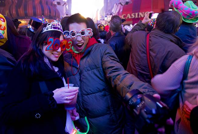 Saya Kamiya and Toshi Wada of Japan take a self-portrait just after midnight during the New Years Eve party at the Fremont Street Experience Tuesday, Jan. 1, 2013.