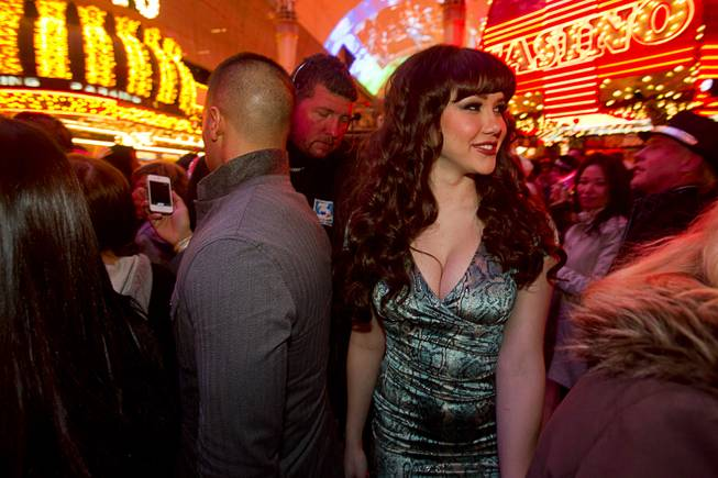 Claire Sinclair, 2011 Playboy Playmate of the Year, makes her way through the New Years Eve party at the Fremont Street Experience Monday, Dec. 31, 2012.