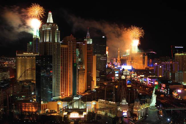 Fireworks explode from the tops of casinos on the Strip during the annual New Year's Eve celebration in Las Vegas Tuesday, Jan.1, 2013.