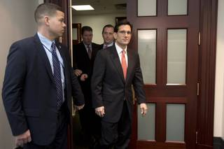 House Majority Leader Eric Cantor of Va., right, leaves a Republican caucus meeting on Capitol Hill in Washington, Tuesday, Jan. 1, 2013. Cantor, the No. 2 Republican in the House leadership says he opposes a Senate-passed measure to avert the so-called fiscal cliff.