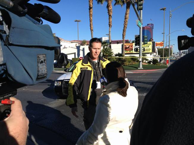 Metro Police Sgt. Richard Strader talks to the media after a fatal accident on Flamingo Road, Jan. 1, 2013.